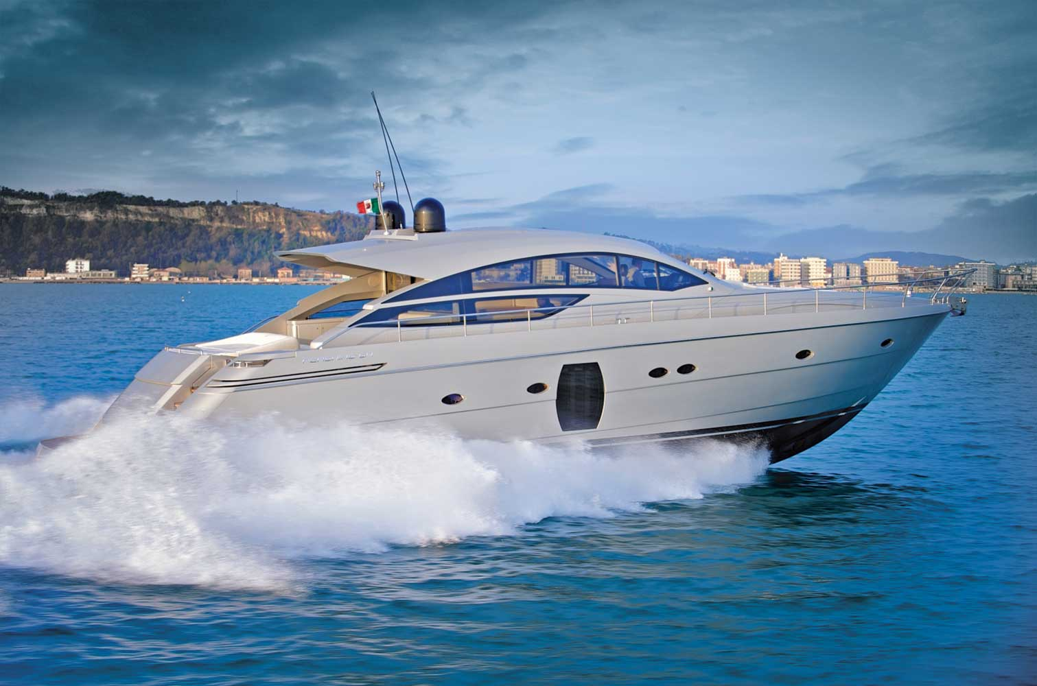 Here is a profile photo of the Pershing 64 motor yacht underway.